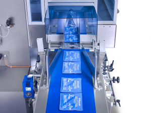SleekWrapper automated flow wrapping machine wrapping medical devices
