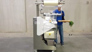 Produce being packaged with a breezy bagger bagging machine